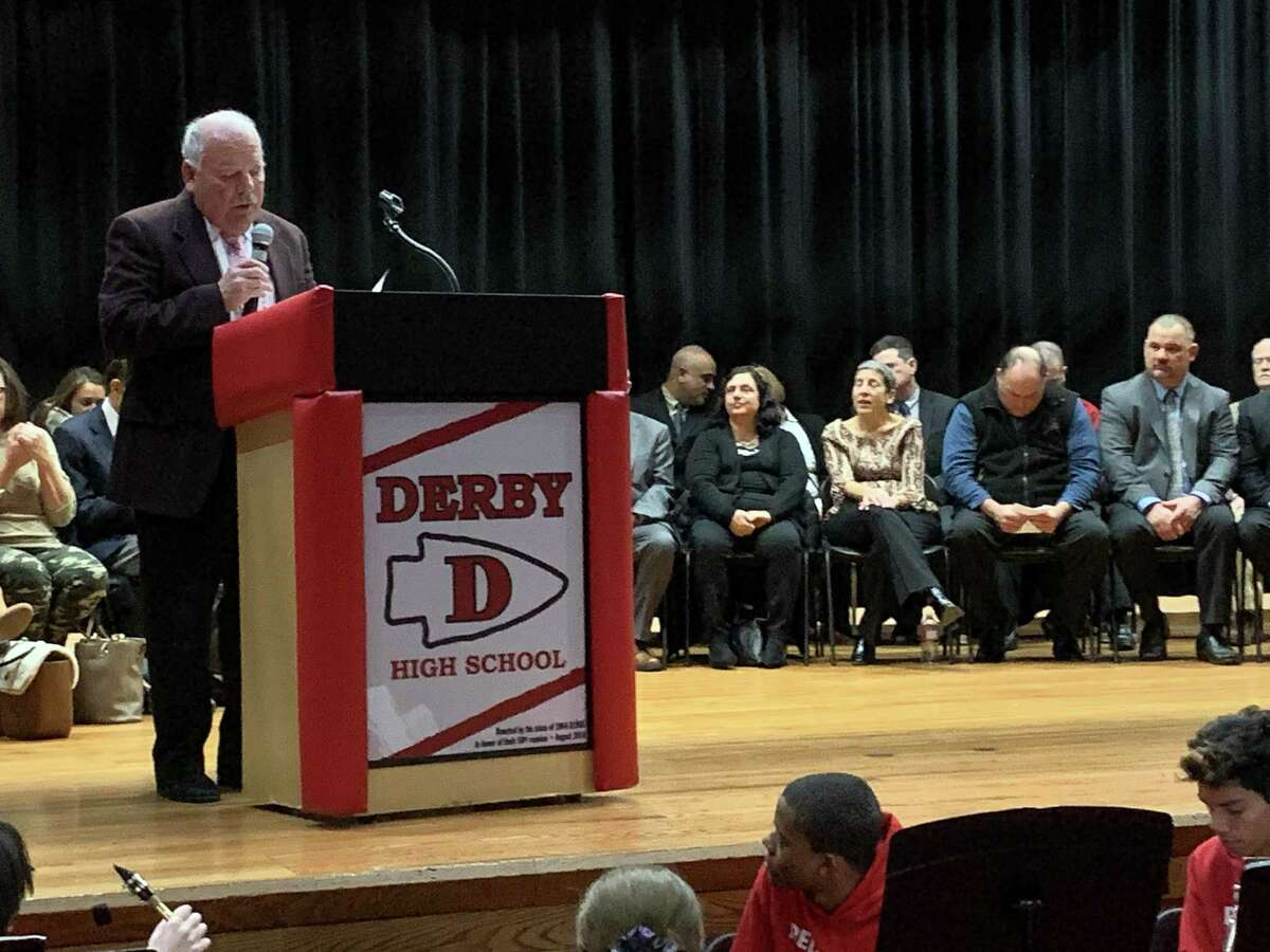 Oxford First Selectman George Temple vows not to return a section of his town to Derby before administering the oath of office to Derby's two constables