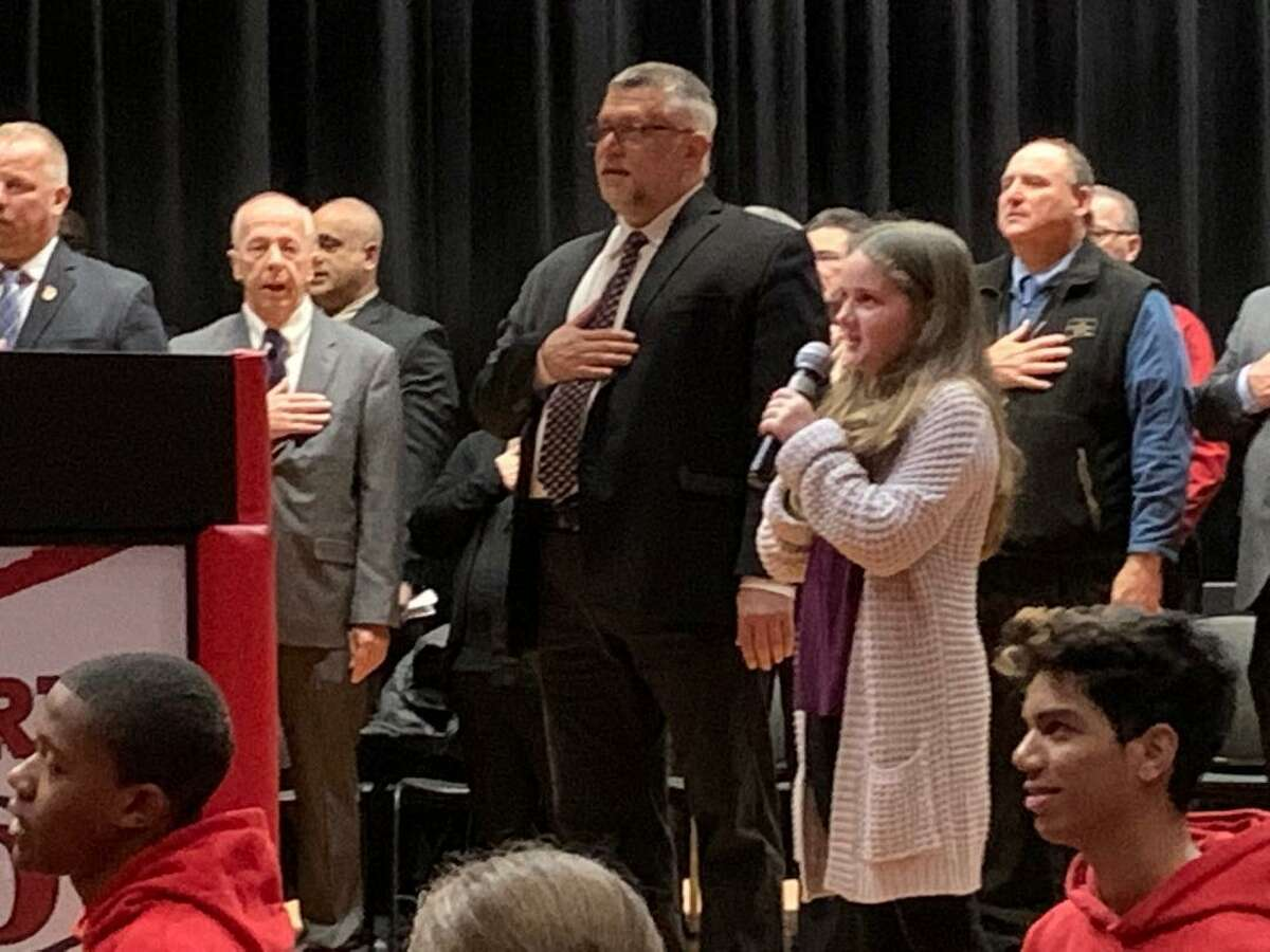 Emma Hyder, the daughter of Alderman Rob Hyder and Board of Education Member Tara Hyder stands next to City/Town Clerk Marc Garofalo as she recites the Pledge of Allegiance during Saturday's inauguration of Derby Mayor Richard Dziekan