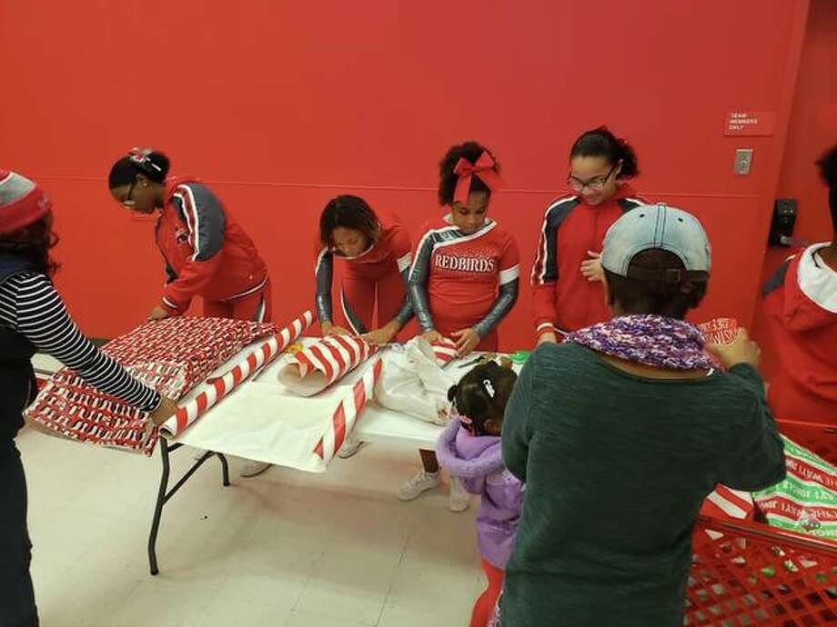 Alton School District students wrap gifts Saturday during the annual Shop With A Cop, organized by the Police Benevolent and Protective Association Alton Unit 14, at Target. The union organization supports officers of the Alton Police Department. Photo: For The Telegraph