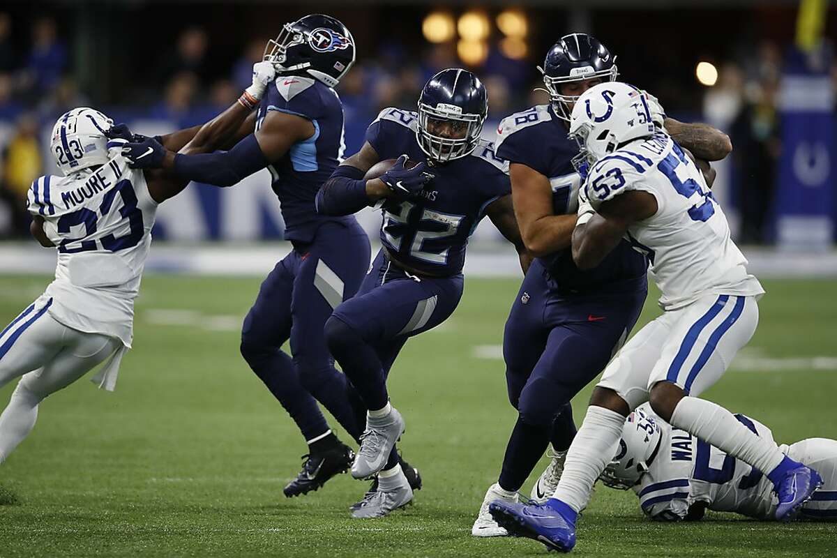 Tennessee Titans running back Derrick Henry (22) runs the ball against the Indianapolis Colts during an NFL football game in Indianapolis, Sunday, Dec. 1, 2019. The Titans won the game 31-17. (Jeff Haynes/AP Images for Panini)