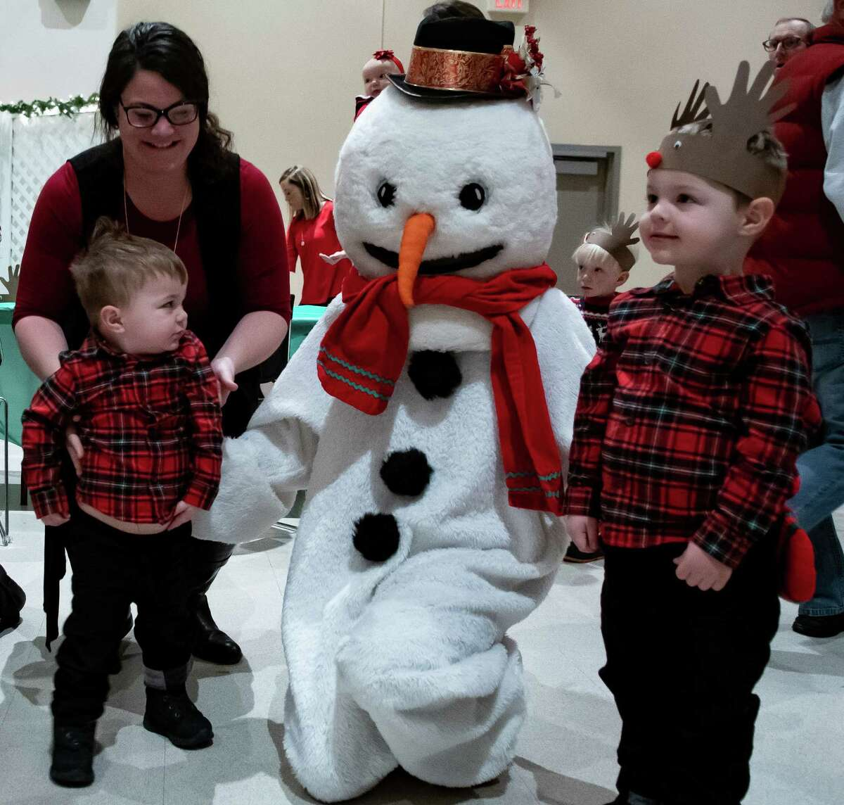 Tina Gac of Saratoga tries to encourage her younger son, Walker Gac, 2, to be in a photo with Frosty and his elder brother, Colton, 3, at the Saratoga Festival of Trees in the City Center of Saratoga Springs, N.Y. on Dec. 7, 2019. (Jenn March, Special to the Times Union )