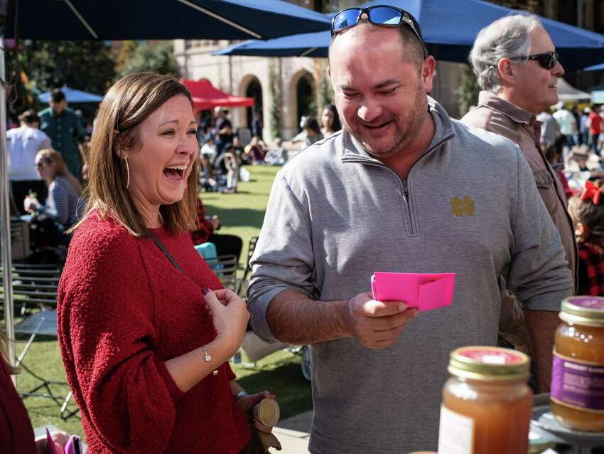 Amber and Scott Phillips react after receiving an envelope full of free cash from The Awesome Foundation in San Antonio, Texas on Saturday, December 7, 2019. The Awesome Foundation is an international organization with local chapters that award $1000 grants each month through an application process that promotes, ?'Awesomeness?