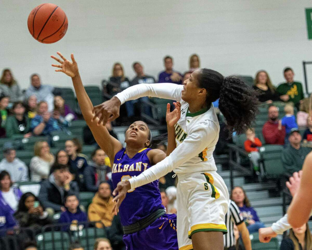Siena College center Tobulayefa Watts blocks a shot by UAlbany guard Khepera Stokes during the Crosstown Showdown at Siena College on Saturday, Dec. 7, 2019 (Jim Franco/Special to the Times Union.)