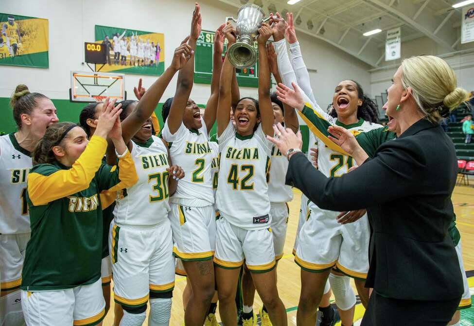 The Siena College women's basketball team hoist the Crosstown Showdown Cup after beating UAlbany at Siena College on Saturday, Dec. 7, 2019 (Jim Franco/Special to the Times Union.)