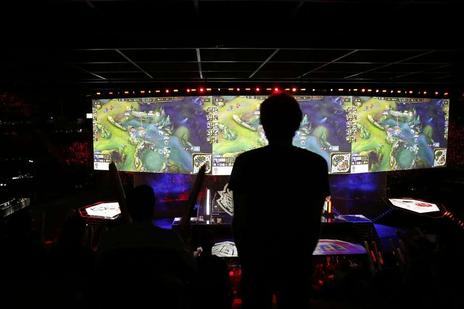 A man stands in the rows during the final of League of Legends tournament between Team G2 Esports and Team FunPlus Phoenix, in Paris, Sunday, Nov. 10, 2019. The biggest e-sports event of the year saw a Chinese team, FunPlus Phoenix, crowned as world champions of the video game League of Legends. Thousands of fans packed a Paris arena for the event, which marked another step forward for the growing esports business. (AP Photo/Thibault Camus) Photo: Thibault Camus, Associated Press