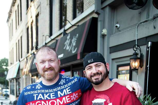 Guests participate in the Ugly Sweater Pub Crawl at the Henke & Pillot pub on Saturday, Dec. 7, 2019, in Houston.