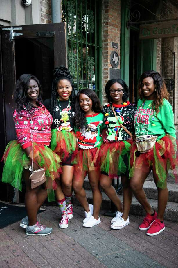 Guests participate in the Ugly Sweater Pub Crawl at the Henke & Pillot pub on Saturday, Dec. 7, 2019, in Houston. Photo: Marie D. De Jesús, Staff Photographer / © 2019 Houston Chronicle