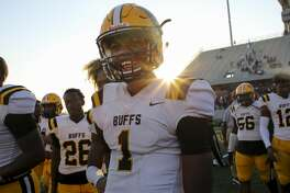 Fort Bend Marshall quarterback Malik Hornsby (1) smiles after his team defeated Manvel High School 40-10 at Freedom Stadium Saturday, Dec. 7, 2019, in Rosharon, Texas. Fort Bend Marshall advanced to the semifinals.
