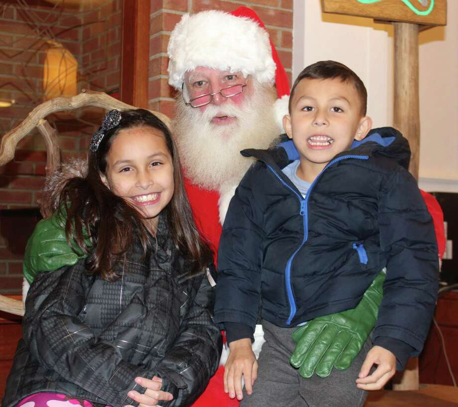 Marianna Ceballos, 9, and her brother Joseph Ceballos, 6, get an early audience with Santa Claus, who was in town Wednesday, Nov. 13, when Bankwell hosted the kickoff party for the Holiday Stroll. The 15th annual celebration of the holidays, which includes the official arrival of Santa, was held Friday, Dec. 6, and Saturday, Dec. 7, hosted by the Chamber of Commerce. He also came to the Town of New Canaan's Waveny Park, and Gregg's Garden Center and Landscaping, LLC, Sunday, Dec. 8, 2019. Photo: John Kovach / Hearst Connecticut Media / New Canaan Advertiser