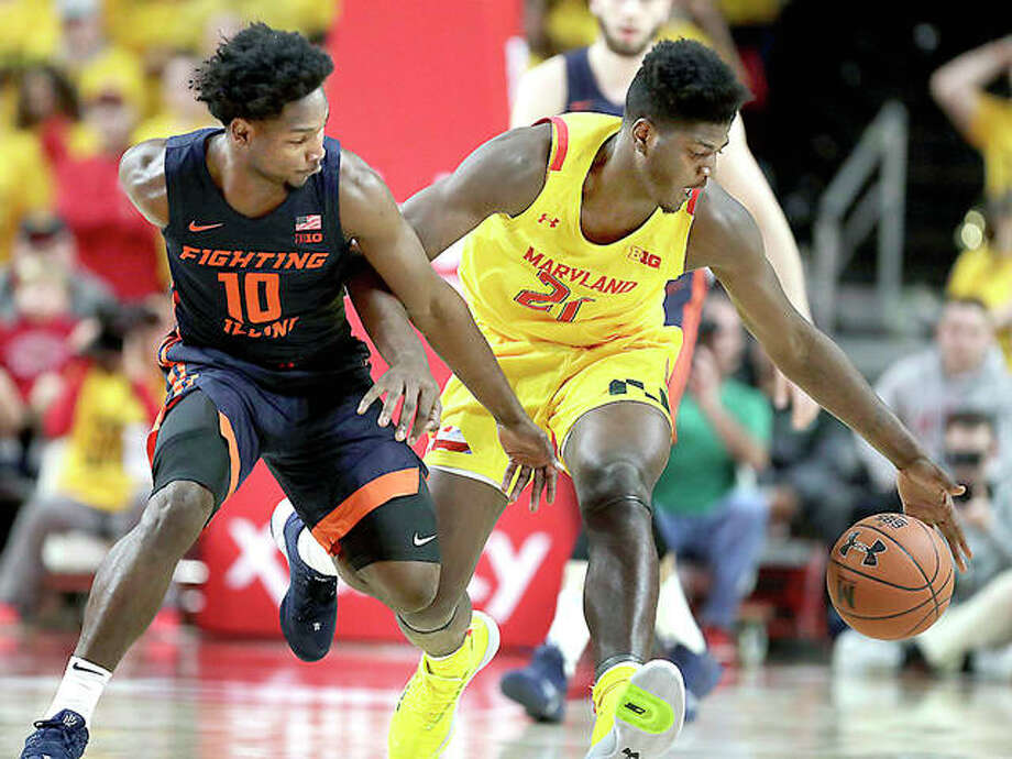 Illinois guard Andres Feliz (10) and Maryland forward Makhi Mitchell (21) battle for a the ball Saturday in College Park, Md. Photo: AP Photo