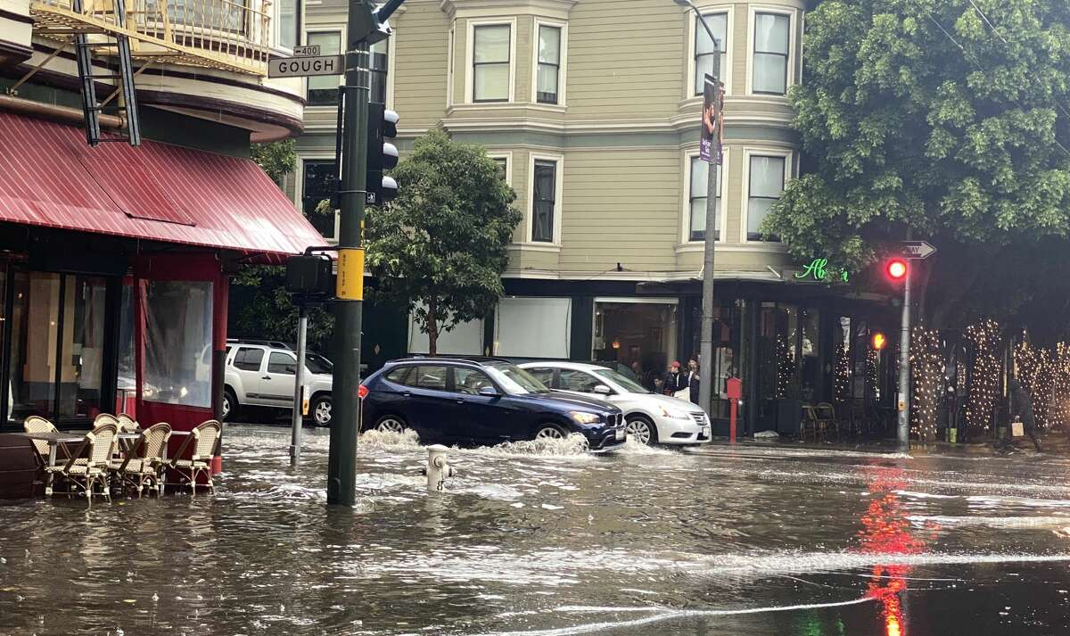 Rain floods the intersection of Hayes and Gough streets in San Francisco on Saturday, Dec. 7, 2019.