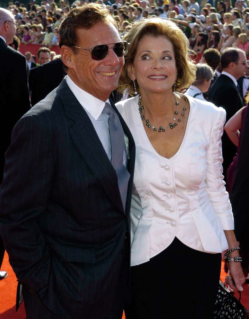 FILE - This Sept. 18, 2005 file photo shows Ron Leibman, left, with his wife Jessica Walter at the 57th Annual Primetime Emmy Awards in Los Angeles. Leibman, who appeared in movies, theater and television in a career that spanned six decades and won a Tony for Tony Kushner's iconic play a€Angels in America,