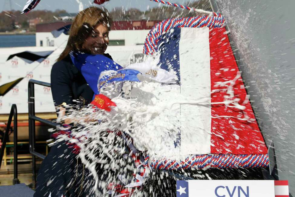 Caroline Kennedy, daughter of former President John F. Kennedy., smashes a bottle on the bow of the ship as she christens of the nuclear aircraft carrier John F. Kennedy at Newport News Shipbuilding in Newport News, Va., Saturday, Dec. 7, 2019. (AP Photo/Steve Helber)