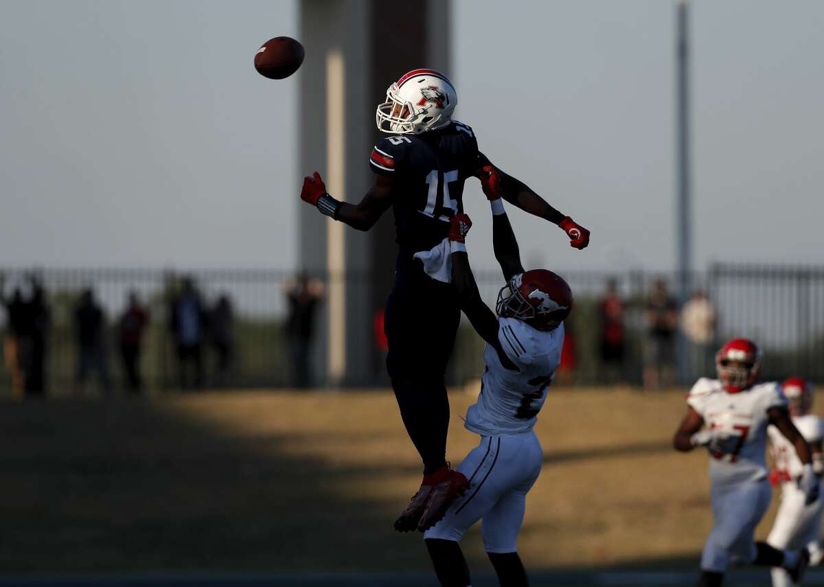 Atascocita Eagles wide receiver Darius Edmonds (15) cannot make the catch defended by North Shore Mustangs Perry Wells (21) during the second half of the high school football playoff game between the between the North Shore Mustangs and the Atascocita Eagles at Sheldon ISD Panther Stadium in Houston, TX on Saturday, December 7, 2019. The Mustangs defeated the Eagles 76-49.