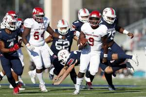 North Shore Mustangs quarterback Dematrius Davis Jr. (9) rushes for a touchdown pursued by Atascocita Eagles Daniel Onwuachi (4) during the first half of the high school football playoff game between the between the North Shore Mustangs and the Atascocita Eagles at Sheldon ISD Panther Stadium in Houston, TX on Saturday, December 7, 2019. The Mustangs lead the Eagles 41-21.