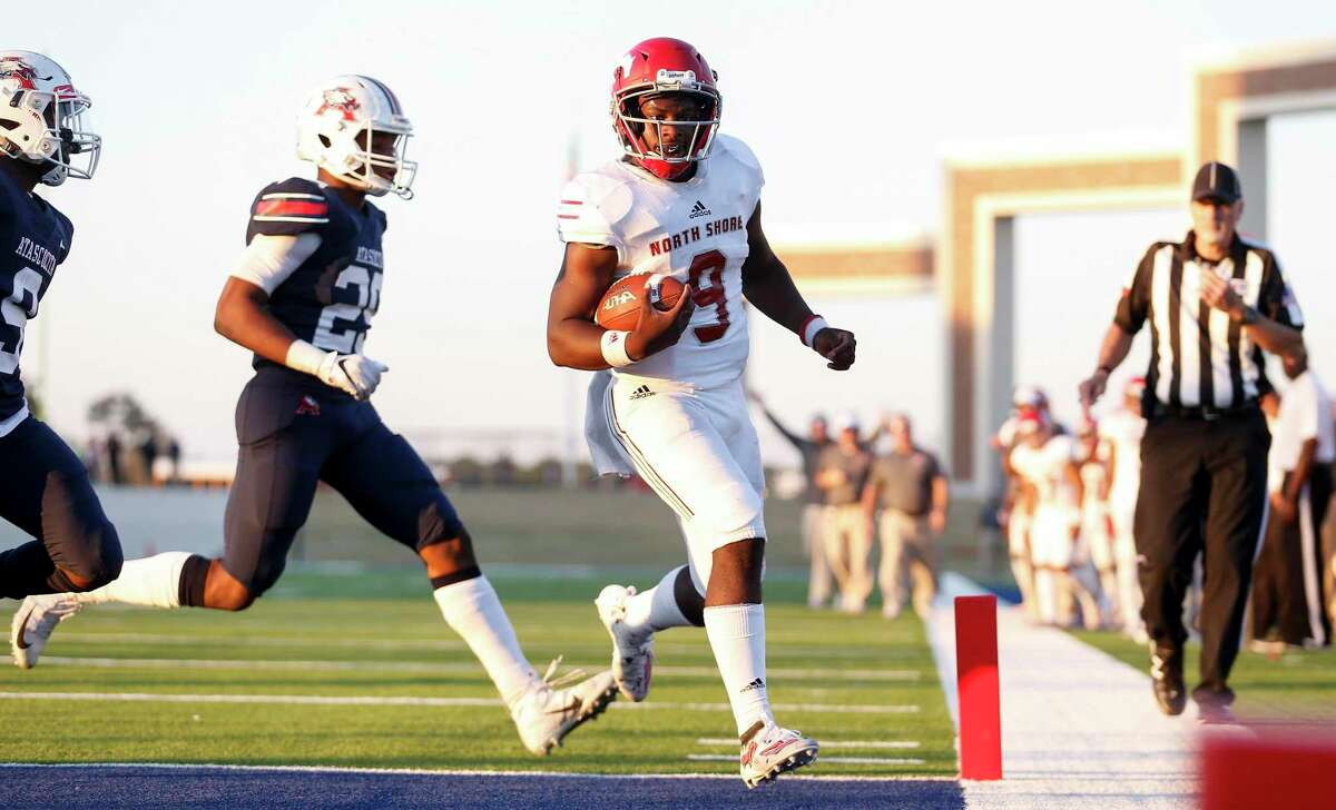 North Shore Mustangs quarterback Dematrius Davis Jr. (9) rushes for a touchdown defended by Atascocita Eagles D.j. Murchison (9) and Avery Morris (29) during the second half of the high school football playoff game between the between the North Shore Mustangs and the Atascocita Eagles at Sheldon ISD Panther Stadium in Houston, TX on Saturday, December 7, 2019. The Mustangs defeated the Eagles 76-49.