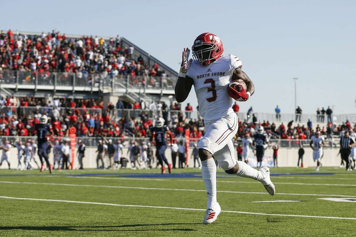 North Shore Mustangs running back Zachary Evans (3) runs for a touchdown after a reception during the first half of the high school football playoff game between the between the North Shore Mustangs and the Atascocita Eagles at Sheldon ISD Panther Stadium in Houston, TX on Saturday, December 7, 2019. The Mustangs lead the Eagles 41-21.