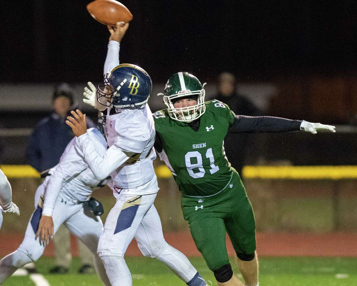 Shenendehowa defensive end Patrick McCane puts pressure on Pine Bush quarterback Kenneth Holland during the Class AA New York state quarterfinals at Shaker High School on Friday, Nov. 15, 2019 (Jim Franco/Special to the Times Union.)