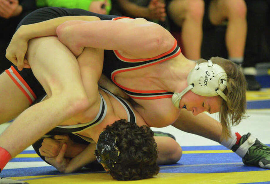 Edwardsville's Grant Schmid, top, wrestles Whitfield's Caleb Gagliano at 145 pounds during Saturday's championship match in the Ron Sauer Duals at Fox High School in Arnold, Mo. Photo: Scott Marion/The Intelligencer