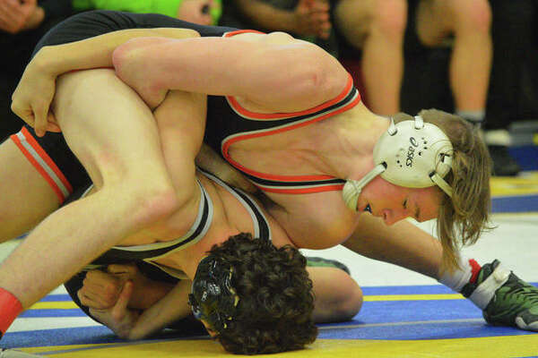 Edwardsville's Grant Schmid, top, wrestles Whitfield's Caleb Gagliano at 145 pounds during Saturday's championship match in the Ron Sauer Duals at Fox High School in Arnold, Mo.