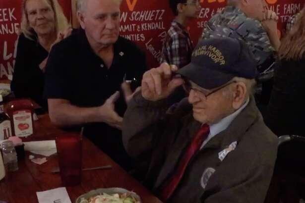 Crowd in San Antonio salutes survivors of the 1941 Pearl Harbor attack.