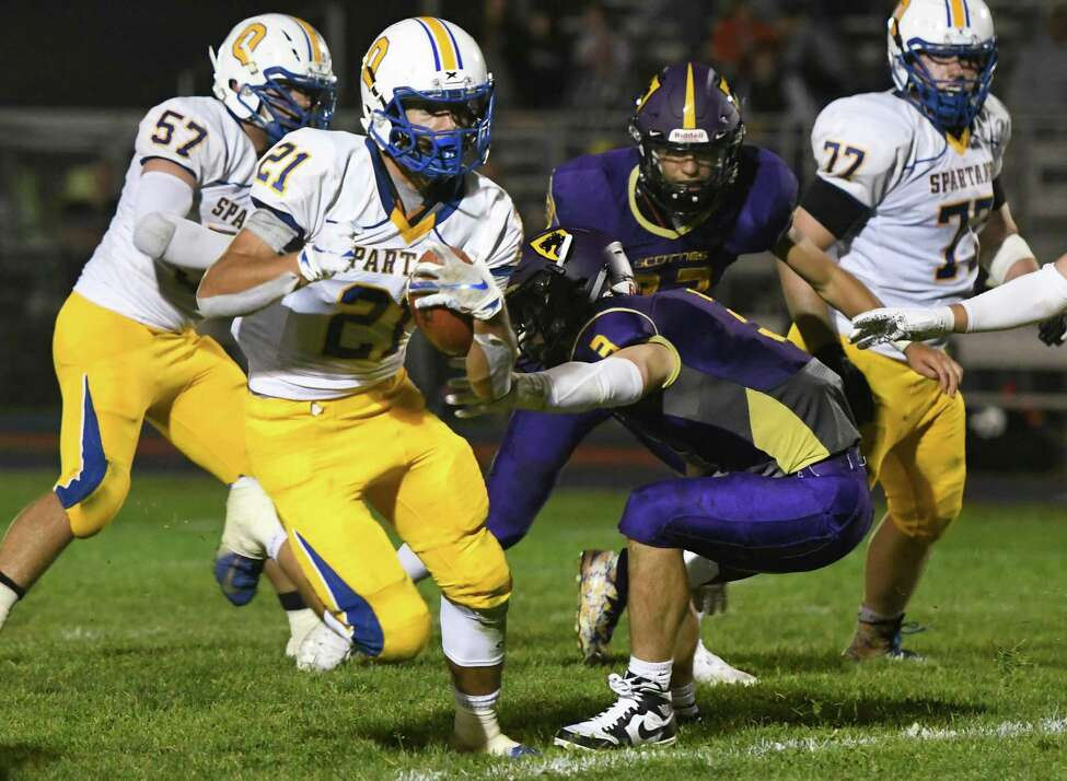 Queensbury running back Jason Rodriguez charges past Ballston Spa linebacker James Prastio Jr. during their first game of the season on Friday, Sept. 6, 2019, in Ballston Spa, N.Y. (Jenn March, Special to the Times Union )