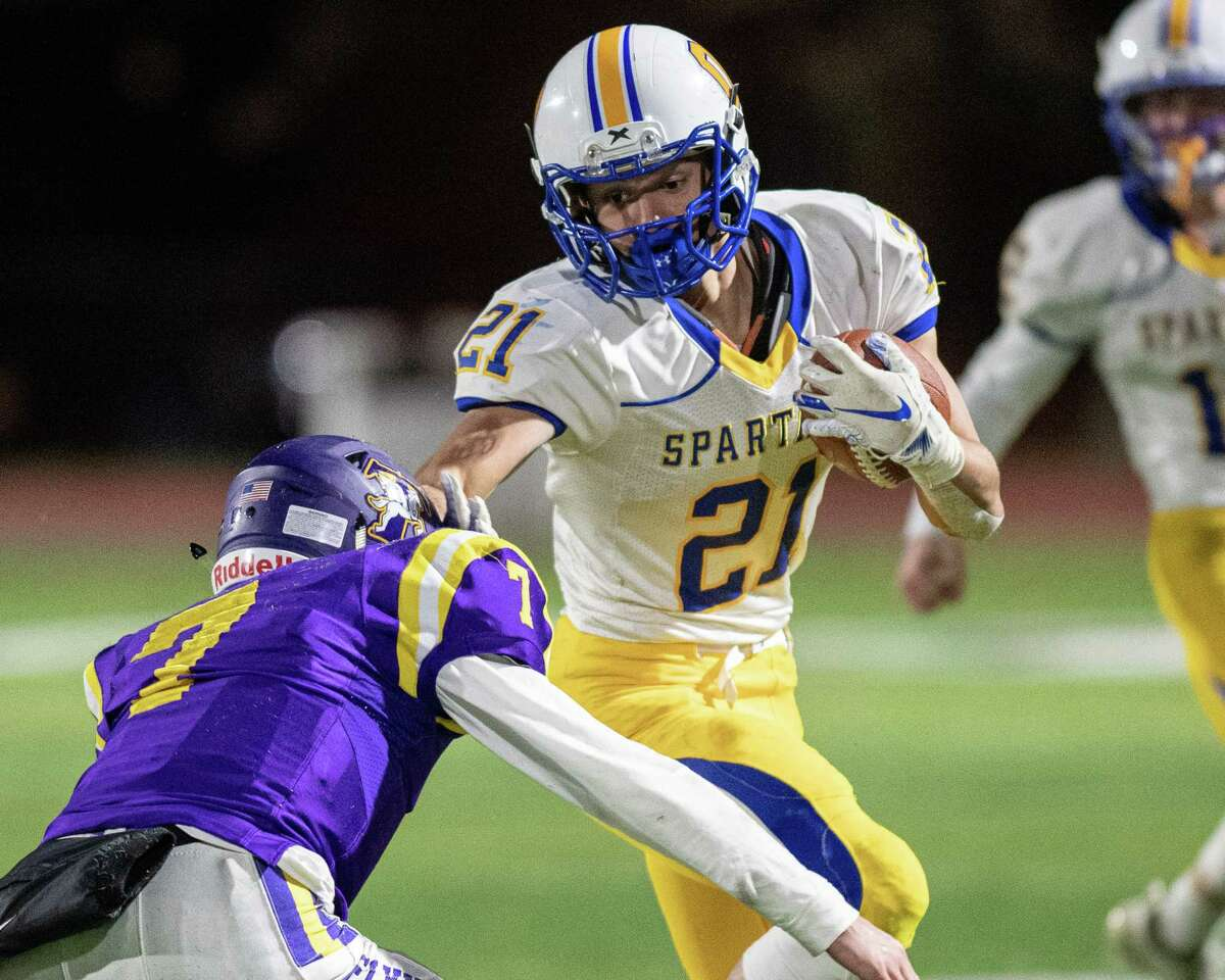 Queensbury running back Jason Rodriguez stiff arms Troy defender Alex Wolfe during the Section II, Class A Super Bowl at Shenendehowa High School on Saturday, Nov. 8, 2019 (Jim Franco/Special to the Times Union.)
