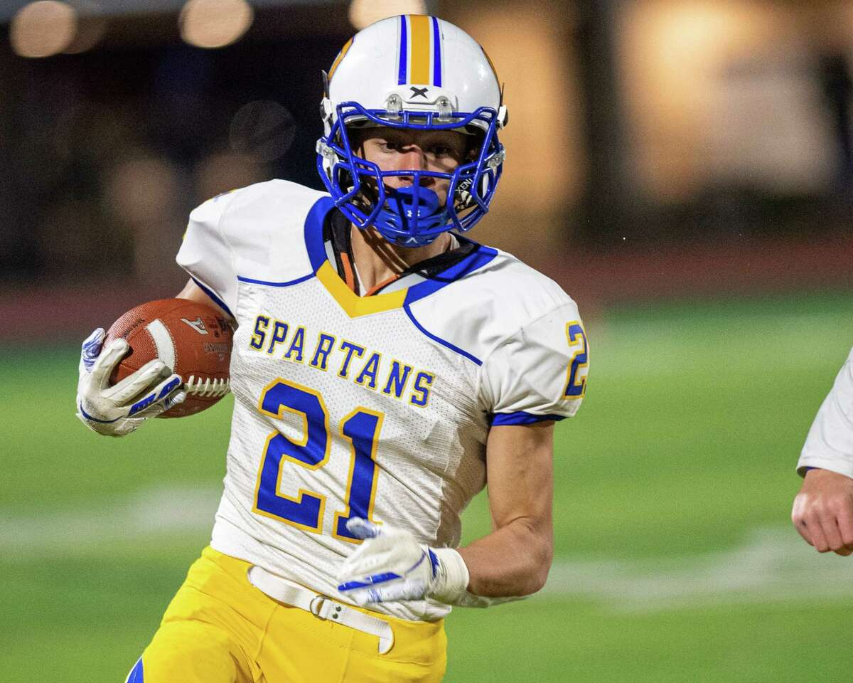 Queensbury running back Jason Rodriguez picks up yardage during the Section II, Class A Super Bowl against Troy at Shenendehowa High School on Saturday, Nov. 8, 2019 (Jim Franco/Special to the Times Union.)