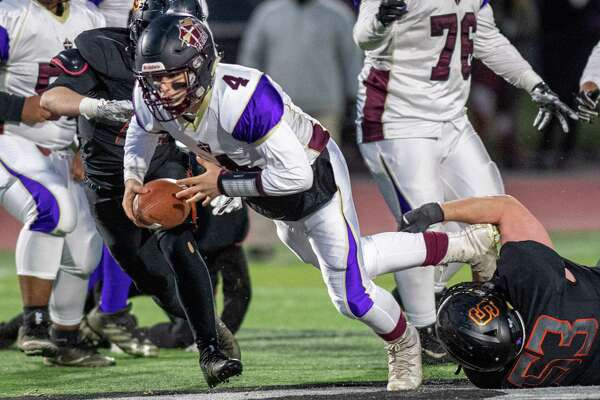 Holy Trinity quarterback Joe Tortello dives for a first down during the Section II, Class B Super Bowl against Schuylerville at Shenendehowa High School on Saturday, Nov. 9, 2019 (Jim Franco/Special to the Times Union.)