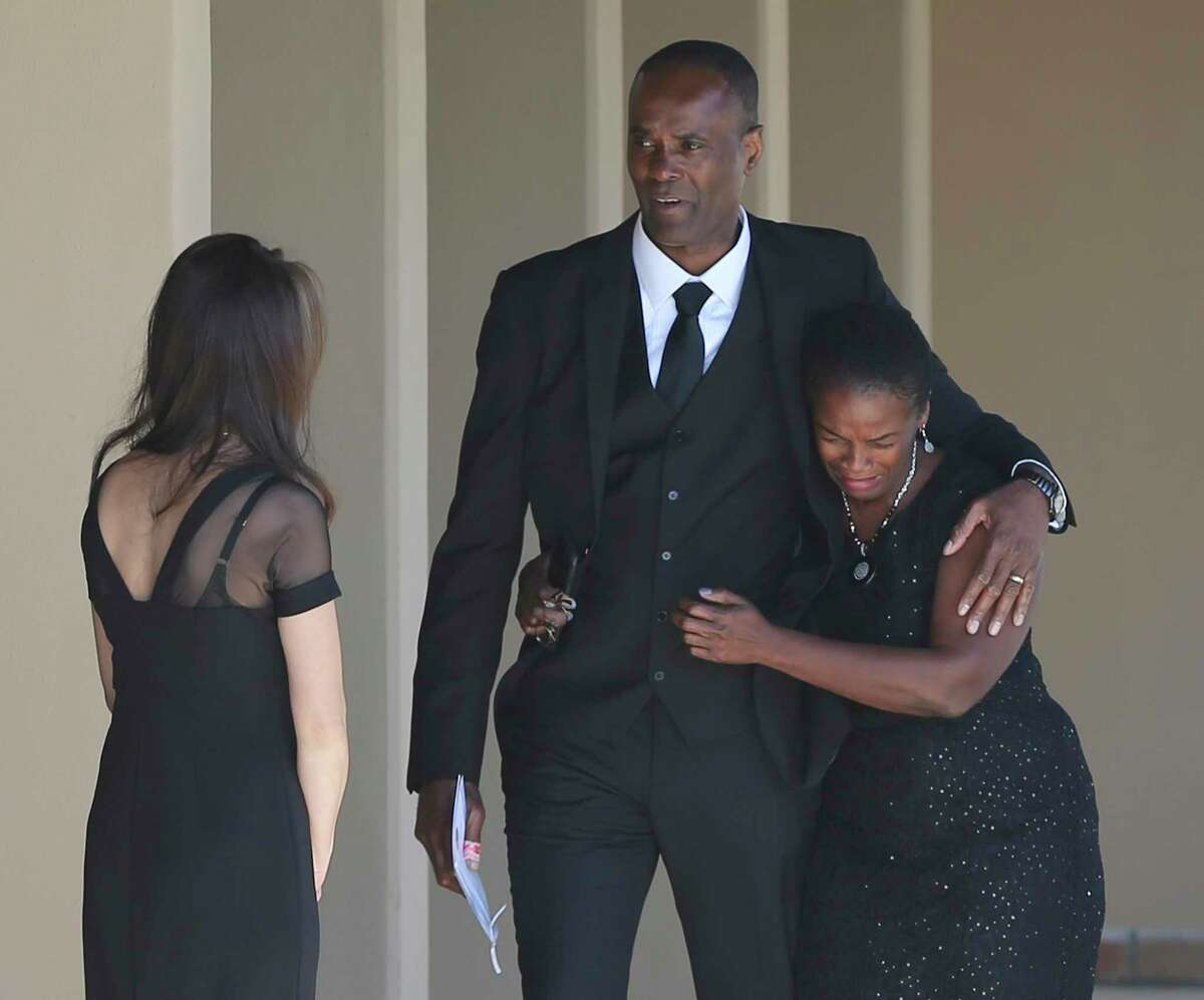 Paul Anderson, father of Andreen McDonald, comforts an unidentified woman during a memorial service for his daughter Saturday. Andreen, 29, disappeared earlier this year and was found dead months later. Her husband, Andre Sean McDonald, is charged with murder in her death.