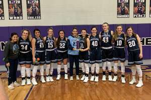 The Greenwood girls basketball team pose with the championship trophy after winning the Navarro Tournament Saturday.