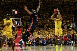 Maryland guard Anthony Cowan Jr. (1) shoots a 3-pointer to tie the game in the final minute against Illinois at the Xfinity Center in College Park, Md., on Saturday. Cowan had 20 points, seven rebounds and six assists.