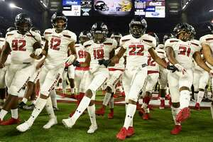 Westfield celebrate the team's win over Dallas Jesuit in a 6A division II regional final high school football game, Dec. 7, 2019, in Houston.