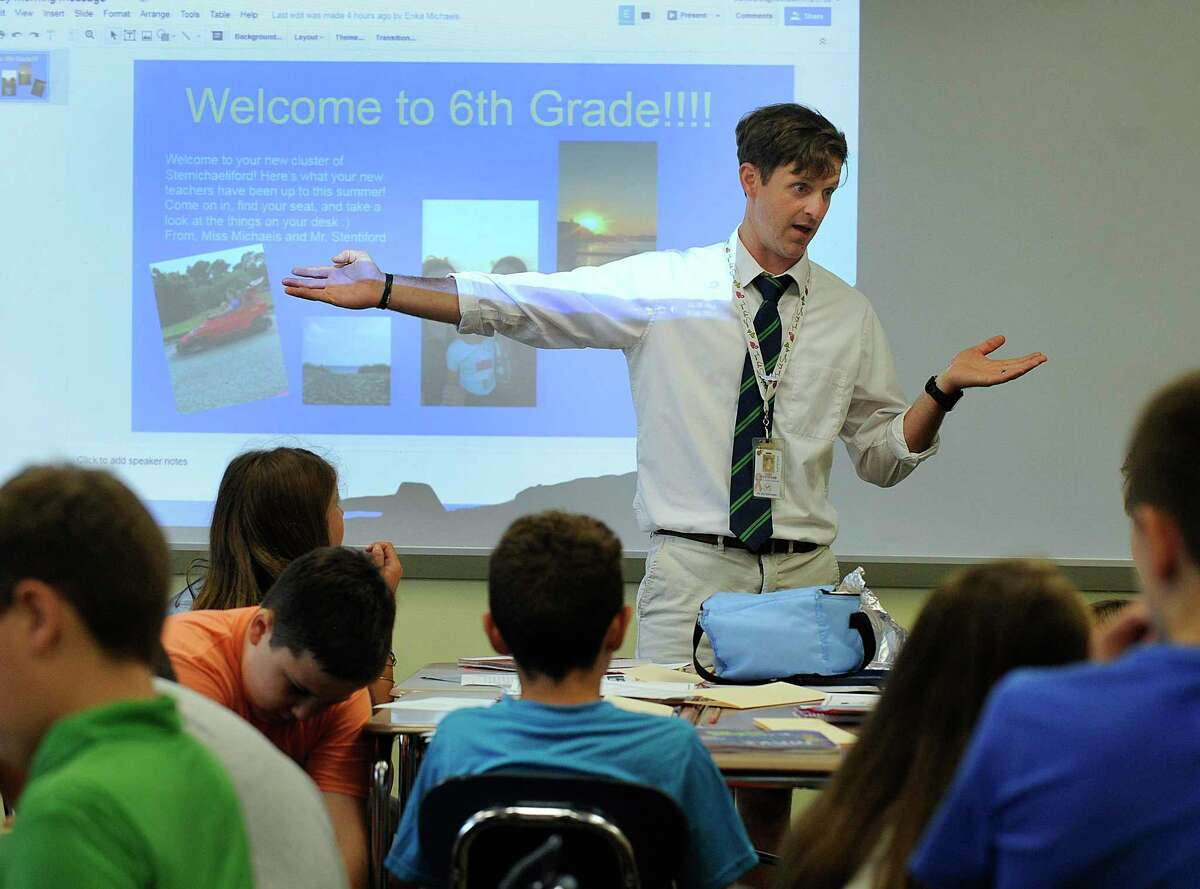 Sixth-grade teacher Todd Stentiford talks to his at Reed Intermediate School in Newtown Monday, August 28, 2017, the first day of school.