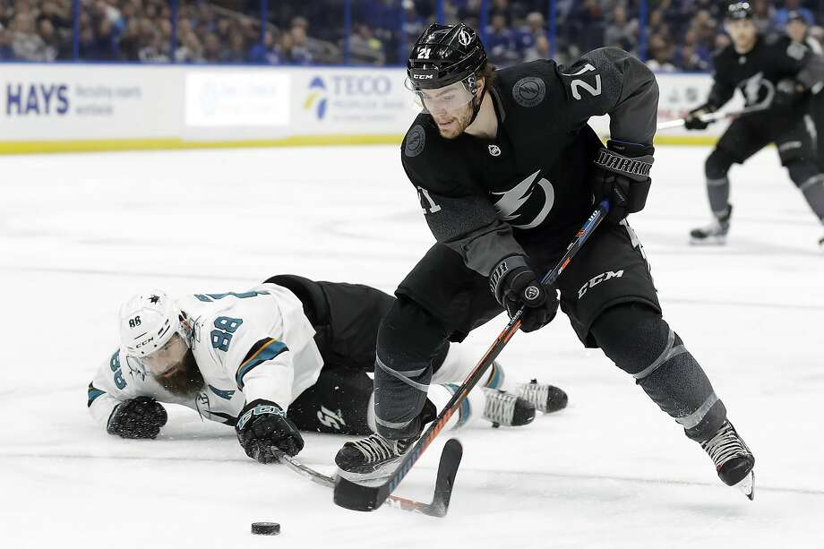 Lightning center Brayden Point gets around a stick check by Sharks defenseman Brent Burns during the second period of the Tampa Bay victory. Photo: Chris O'Meara / Associated Press