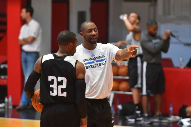Adrian Griffin, father of UConn's Aubrey Griffin, takes part in practice while with the Orlando Magic.