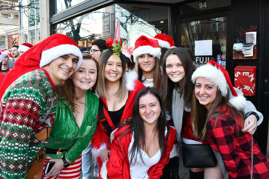 Santas swarmed the streets of Stamford during the annual SantaCon bar crawl on December 7, 2019. Revelers dressed in holiday garb took advantage of drink specials at participating bars. Were you SEEN? Photo: Vic Eng / Hearst Connecticut Media Group