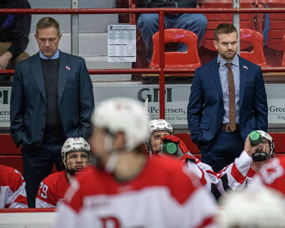 RPI mena€™s hockey head coach Dave Smith, left, and assistant coach Scott Moser do not like a call during a game against Brown University at RPI in Troy, New York on Saturday, Dec. 7, 2019 (Jim Franco/Special to the Times Union.)