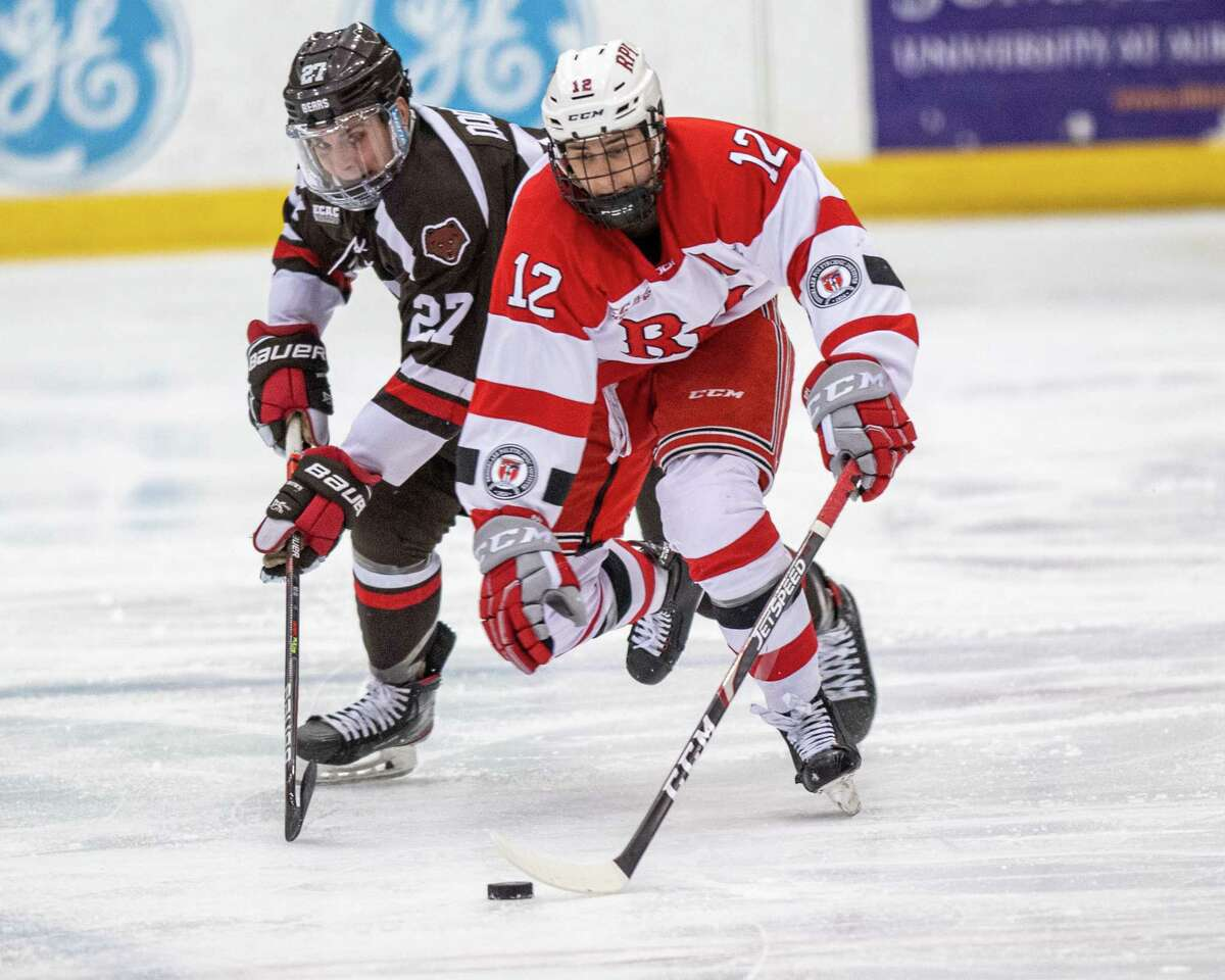 RPI forward Chase Zieky fights off Brown University forward Trey Dodd during a game at RPI in Troy, New York on Saturday, Dec. 7, 2019 (Jim Franco/Special to the Times Union.)