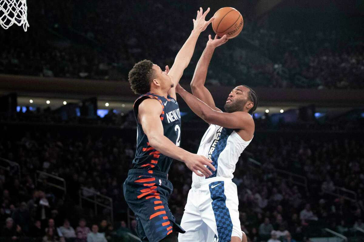 Indiana Pacers forward T.J. Warren (1) goes to the basket against New York Knicks forward Kevin Knox II (20) in the first half of an NBA basketball game, Saturday, Dec. 7, 2019, at Madison Square Garden in New York. (AP Photo/Mary Altaffer)