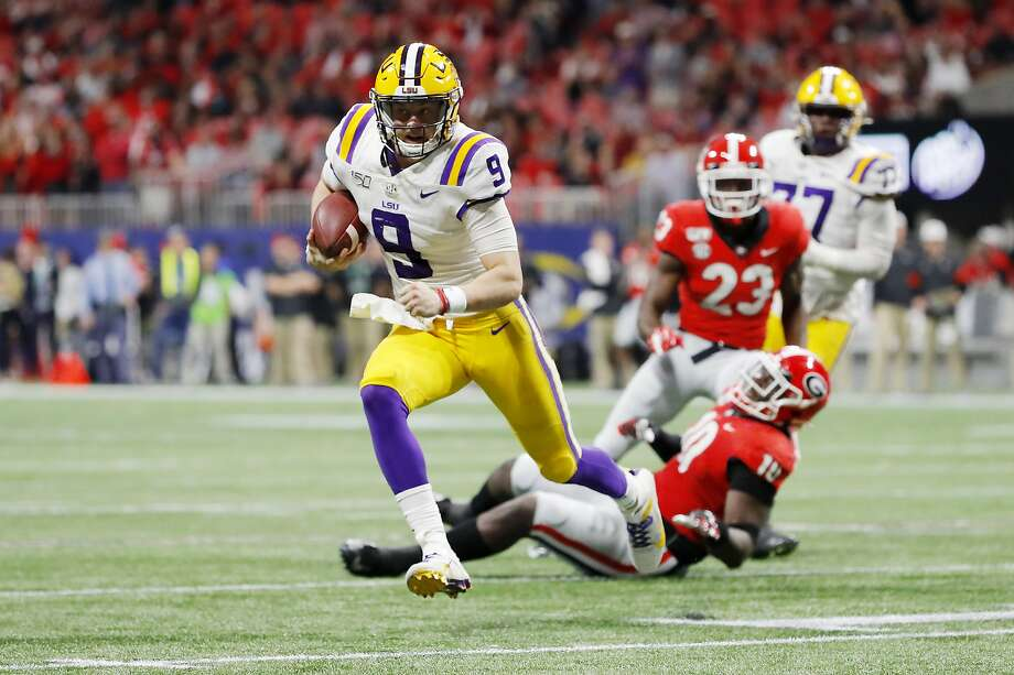 ATLANTA, GEORGIA - DECEMBER 07: Joe Burrow #9 of the LSU Tigers runs with the ball in the second half against the Georgia Bulldogs during the SEC Championship game at Mercedes-Benz Stadium on December 07, 2019 in Atlanta, Georgia. (Photo by Kevin C. Cox/Getty Images) Photo: Kevin C. Cox, Getty Images
