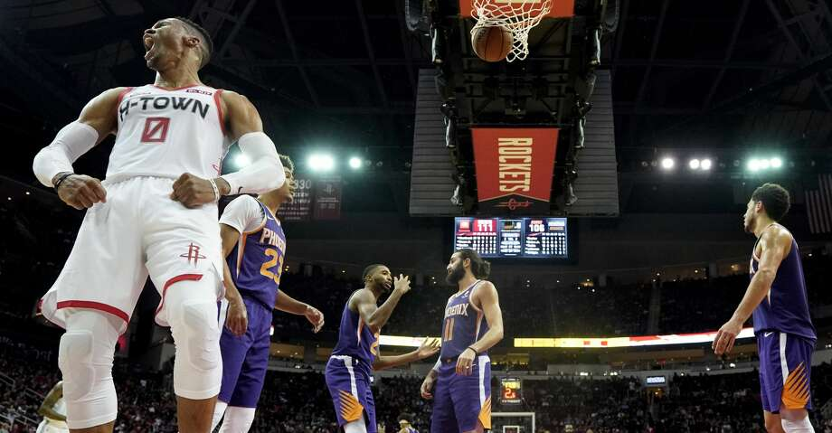 Houston Rockets' Russell Westbrook (0) yells after making a basket while being fouled during the second half of an NBA basketball game against the Phoenix Suns Saturday, Dec. 7, 2019, in Houston. The Rockets won 115-109. (AP Photo/David J. Phillip) Photo: David J. Phillip/Associated Press