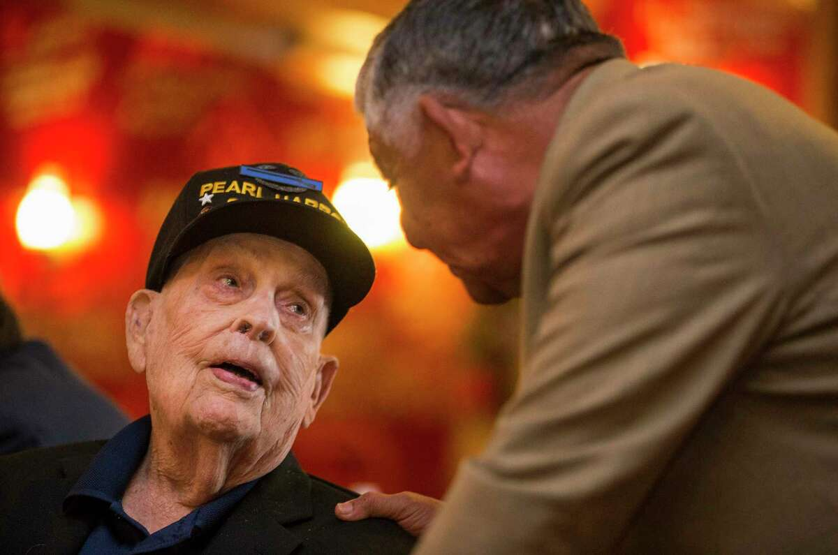 Pearl Harbor survivor Kenneth Platt, 98, left, speaks with retired Maj. Gen. Alfred Valenzuela after the remembrance luncheon.