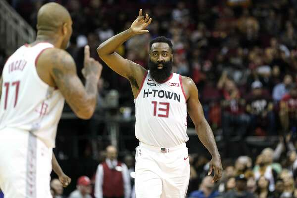 Houston Rockets' James Harden (13) celebrates with PJ Tucker (17) during the second half of an NBA basketball game against the Phoenix Suns Saturday, Dec. 7, 2019, in Houston. The Rockets won 115-109. (AP Photo/David J. Phillip)