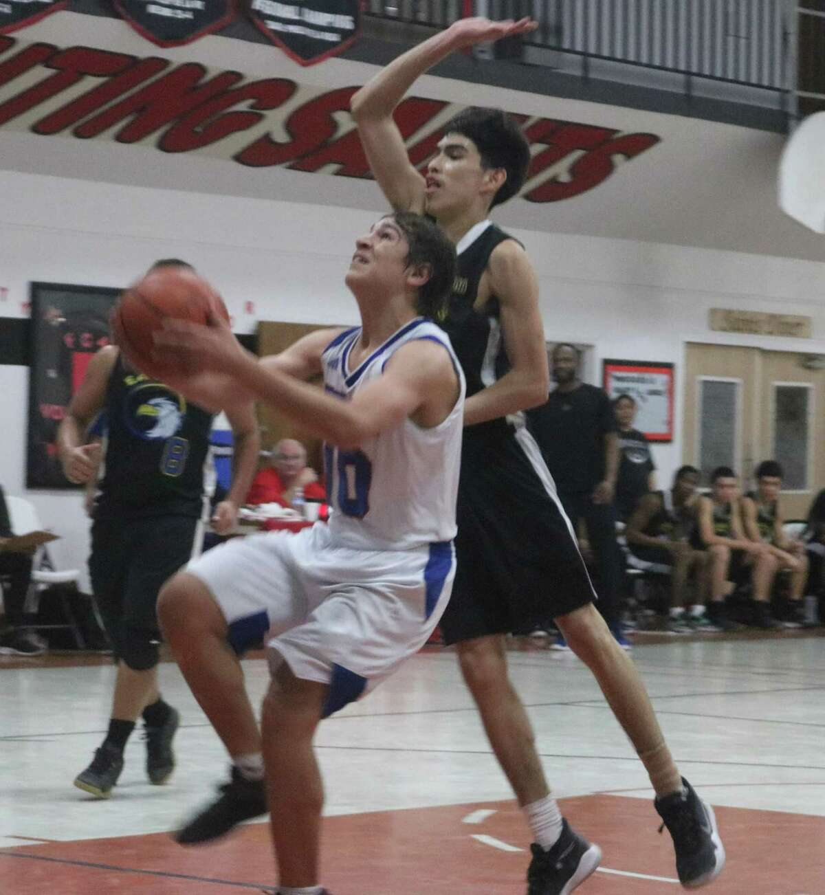 Matthew Ybarra gets fouled in the paint by a Sanchez defender during Saturday night's tournament championship game. One didn't see Ybarra in the paint very much considering he led the Warriors with 10 3-point goals for the three games they played.