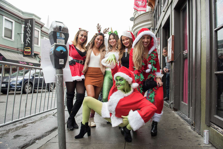 It's that time of year in San Francisco when hundreds of Santas flock to Union Square to begin a one of the most notorious bar crawls in this city's history. Photo: Blair Heagerty / SFGate