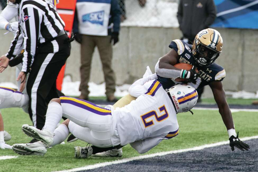 Montana State's Isaiah Ifanse plows over Albanya€™s Tyler Carswell on his way to a first half touchdown Saturday, Dec. 7, 2019, at Bobcat Stadium in Bozeman.