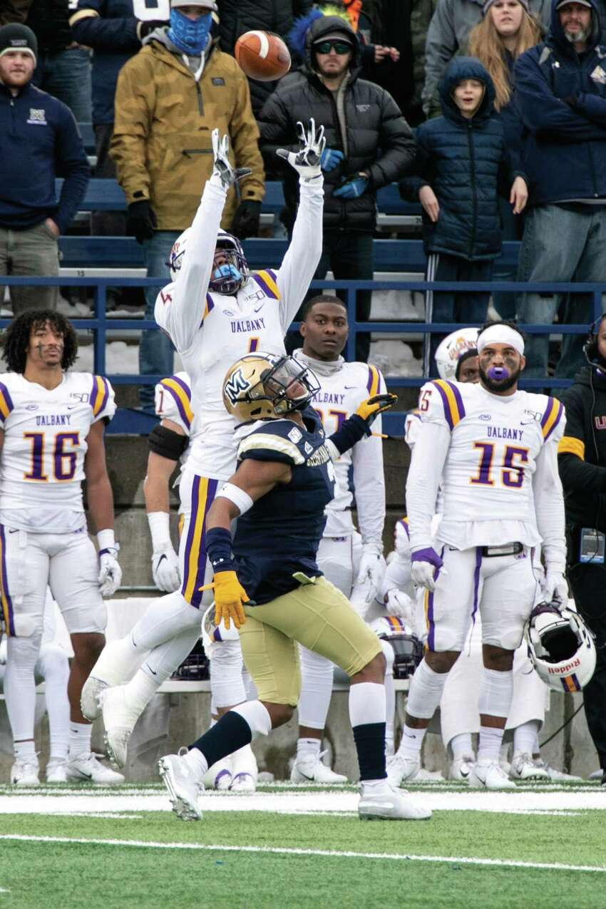 University at Albany receiver Juwan Green catches the ball over the head of Montana State's Tyrel Thomas Saturday, Dec. 7, 2019, at Bobcat Stadium in Bozeman. Green took the catch all the way for the opening touchdown of the game.