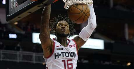 Houston Rockets' Ben McLemore (16) dunks the ball against the Phoenix Suns during the first half of an NBA basketball game Saturday, Dec. 7, 2019, in Houston. (AP Photo/David J. Phillip)