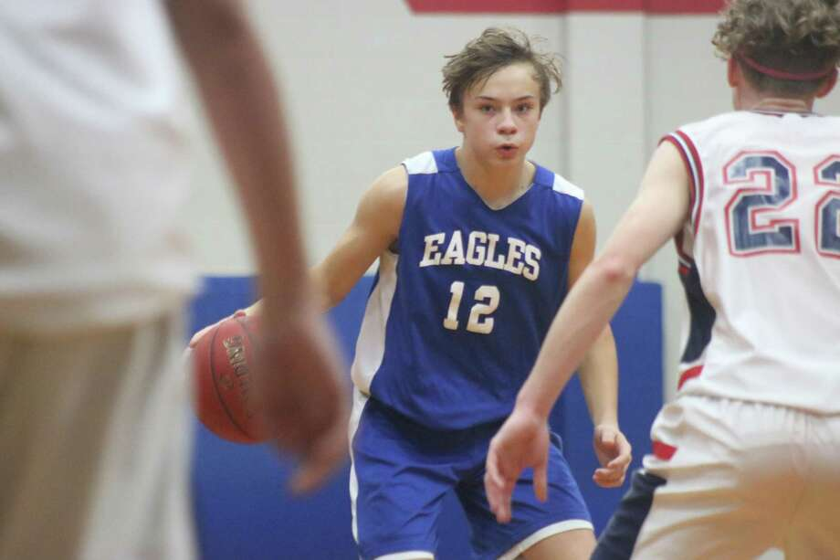 Barbers Hill Junior High player Connor Cowen (12) brings the ball up the floor against Clear Lake Intermediate's defense Friday night. The 8A Gold Division contest had Cowen and Co. win the game 65-46. Photo: Robert Avery
